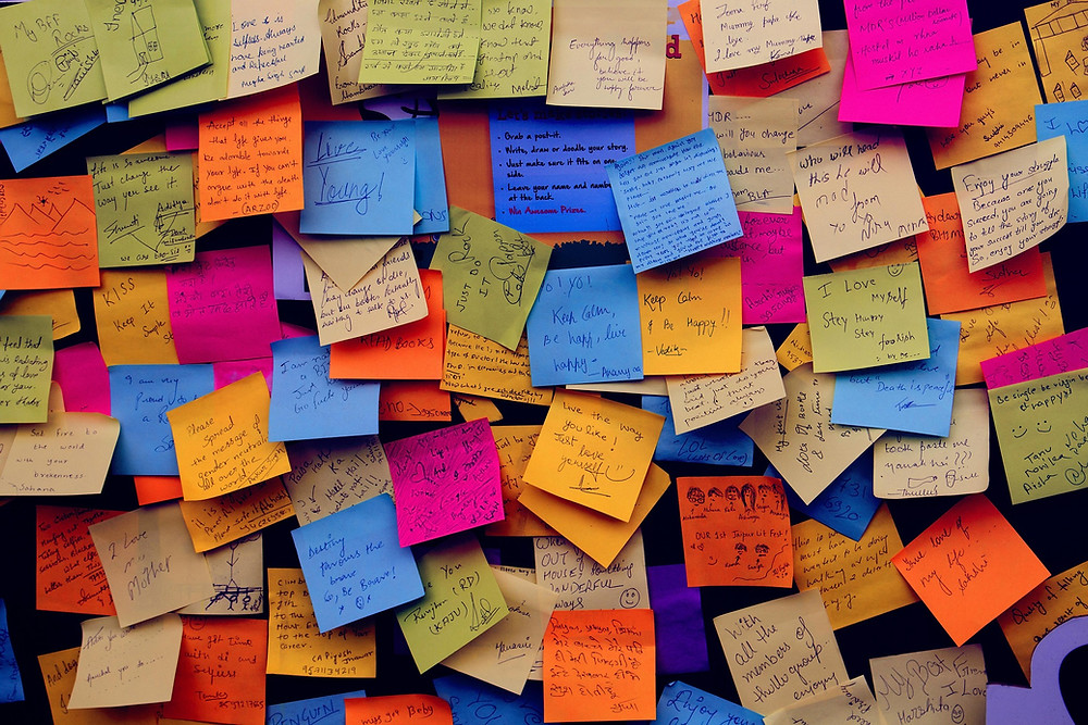post-it notes with sayings of positive encouragement