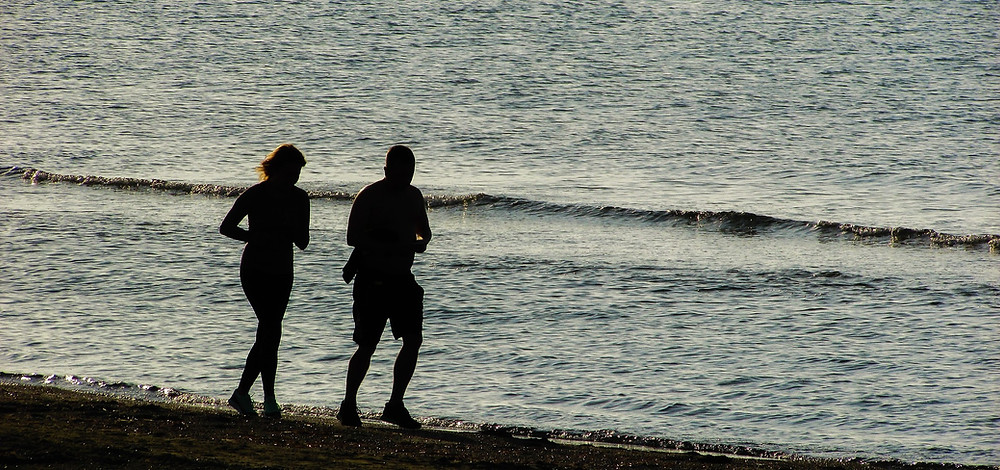 two runners on the beach
