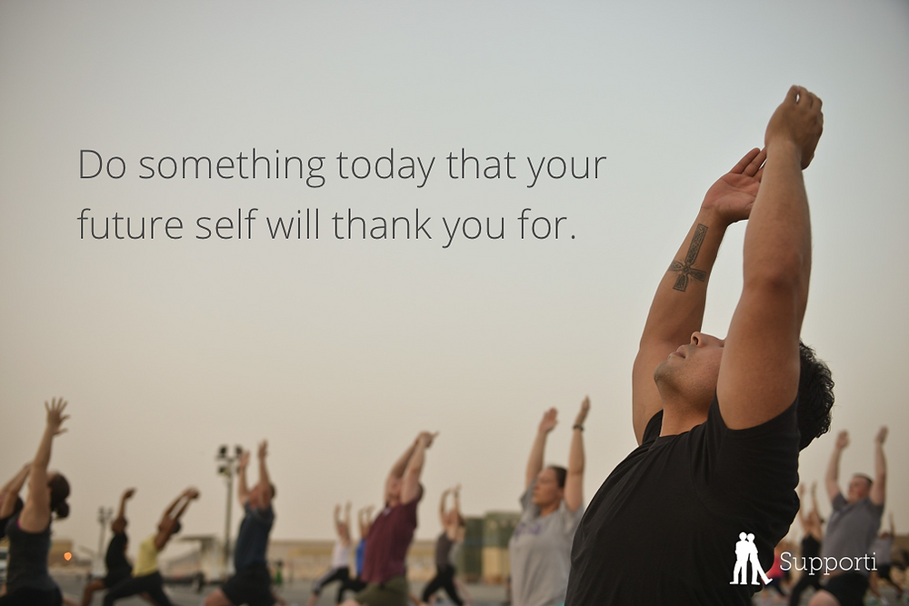 "group of people doing yoga with the words ""do something today that your future self with thank you for"""