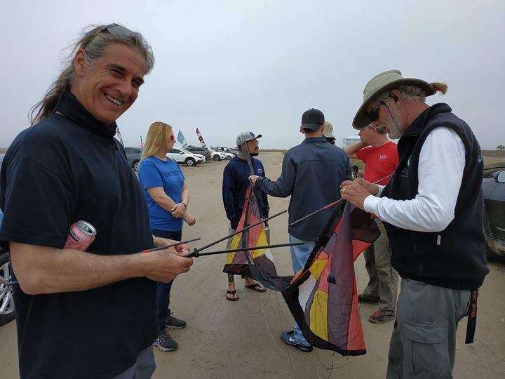 Scott Weider helping with kite assembly
