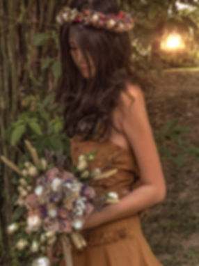 girl in rustic floral headband and wildflower bouquet