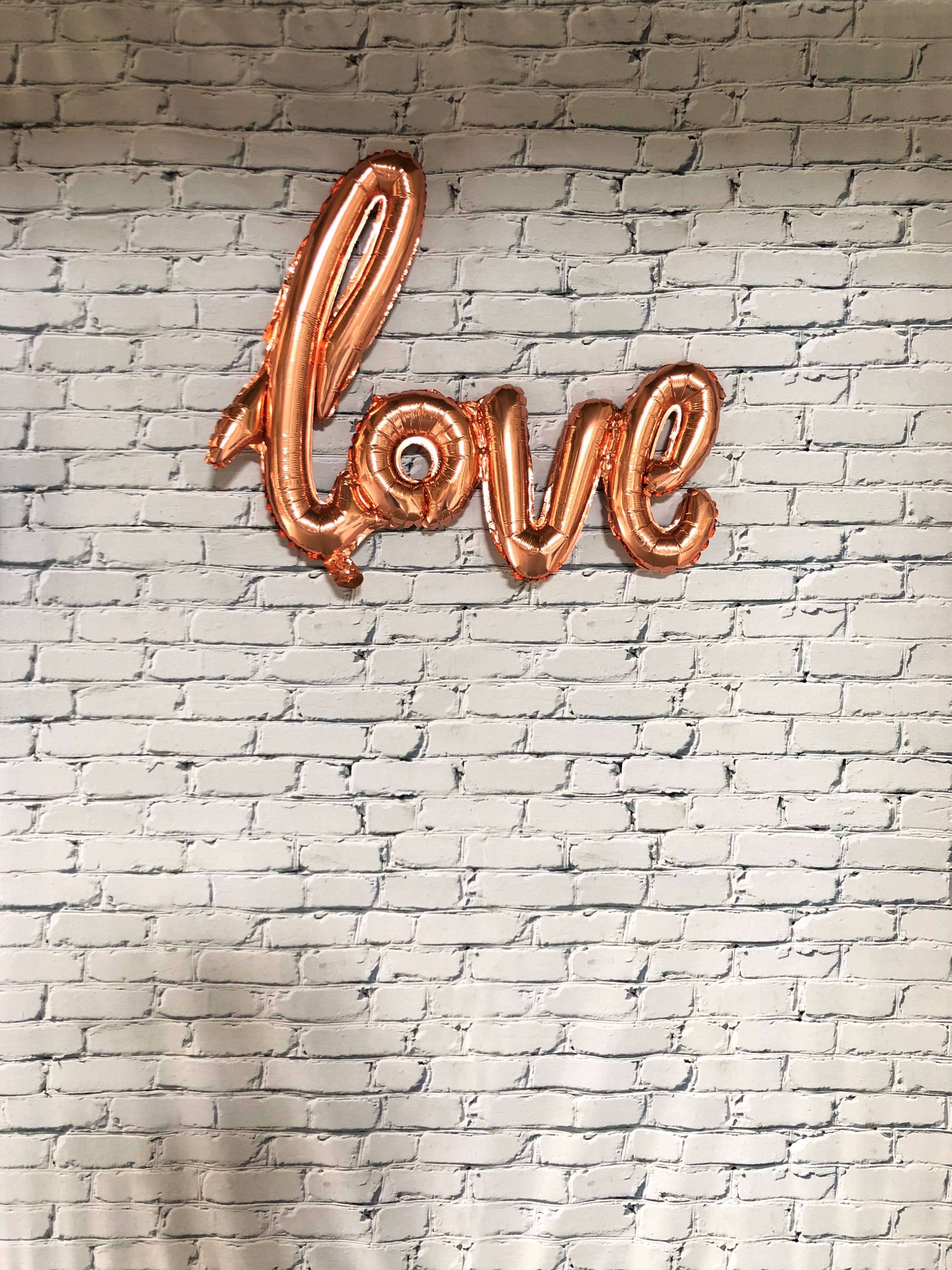 White brick with love sign
