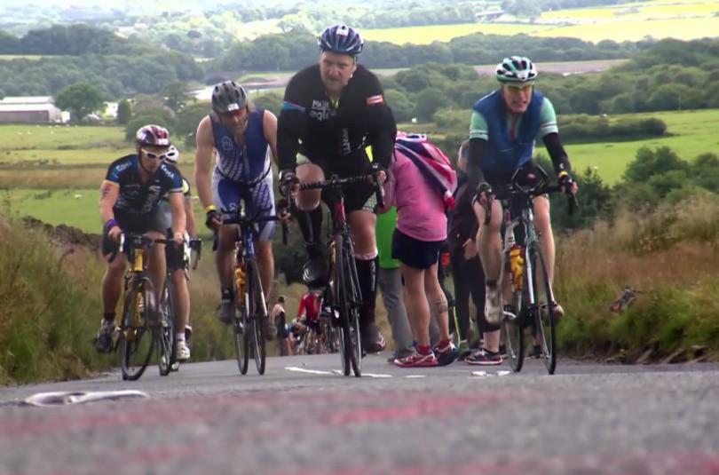 Cyclists on a tough climb