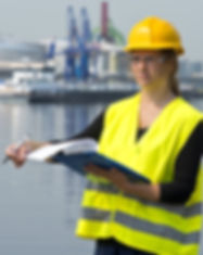 Female foreman turning a page on her cli