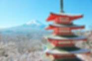 red%20and%20white%20pagoda%20temple%20near%20snow%20covered%20mountain%20during%20daytime_edited.jpg