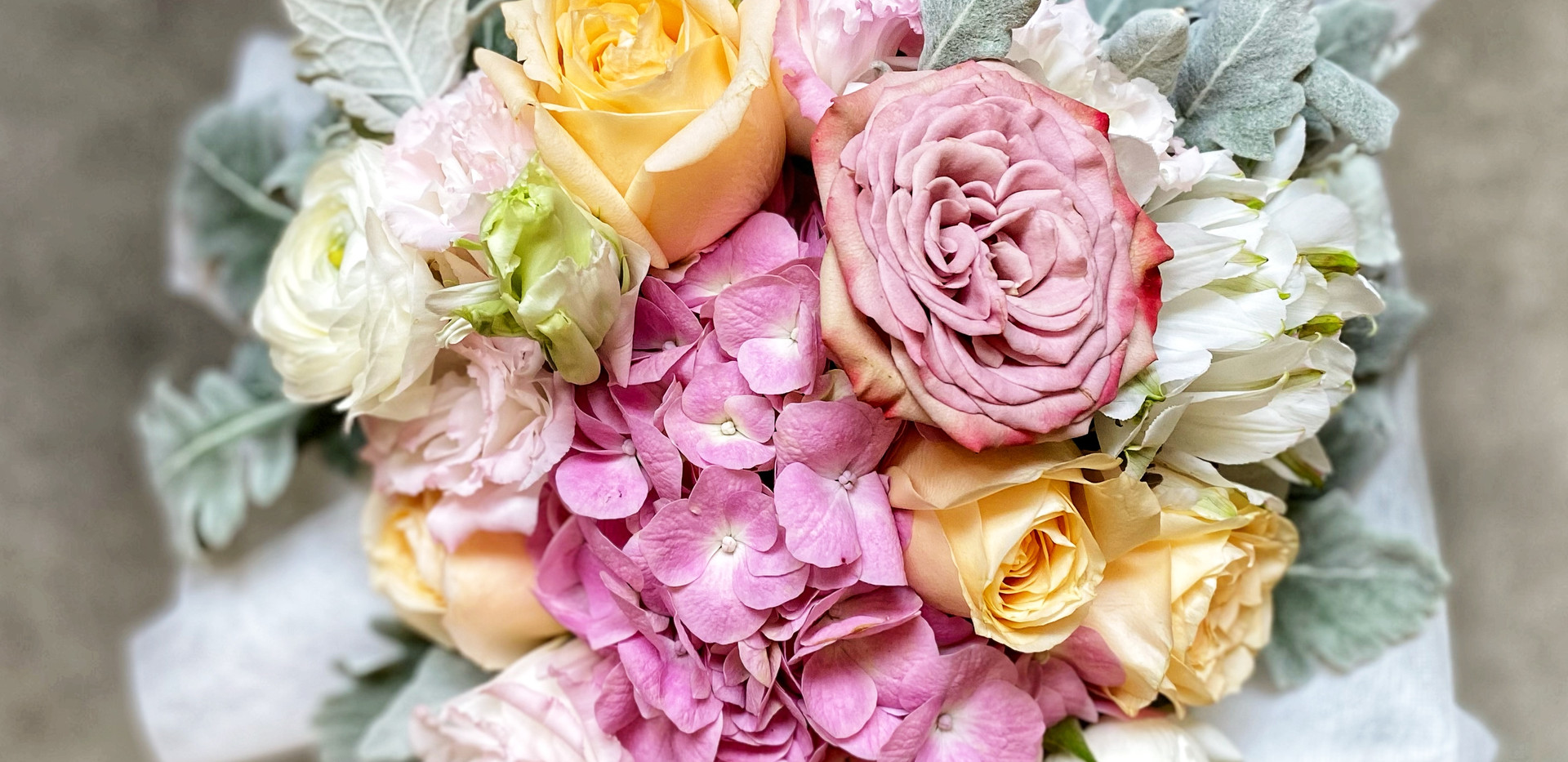 Pink Hydrangea bouqeut accented with a Cuppucino rose