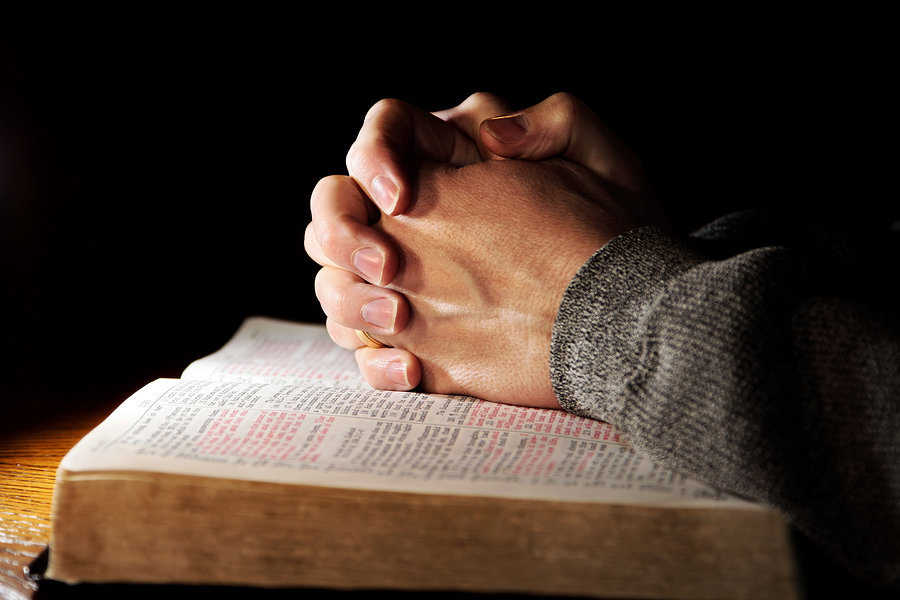 bigstock-Praying-Hands-Man--Bible-278059