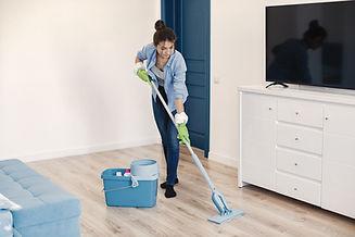 housewife-woking-at-home-lady-in-blue-shirt-woman-clean-floor.jpg