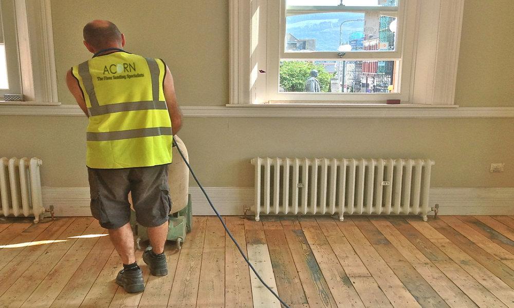 Floor sanding a pine plank floor using a lagler floor sander