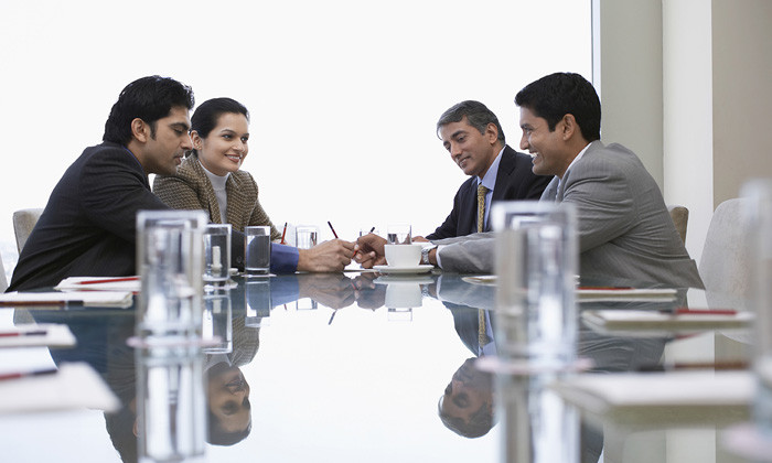 Employees animatedly participating in a workplace meeting(PC: DREAMSTIME.COM)