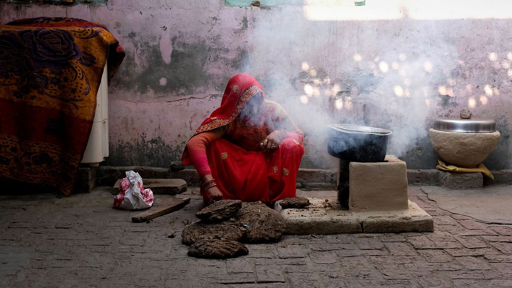 A woman burning solid fuel (PC: UC BERKELEY NEWS)