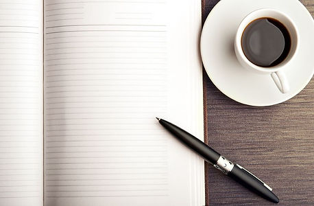 Coffee, paper and pen.