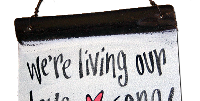'We're living our love song' metal sign