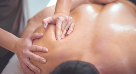 Physiotherapist%2520massaging%2520male%2520patient%2520with%2520injured%2520shoulder%2520b