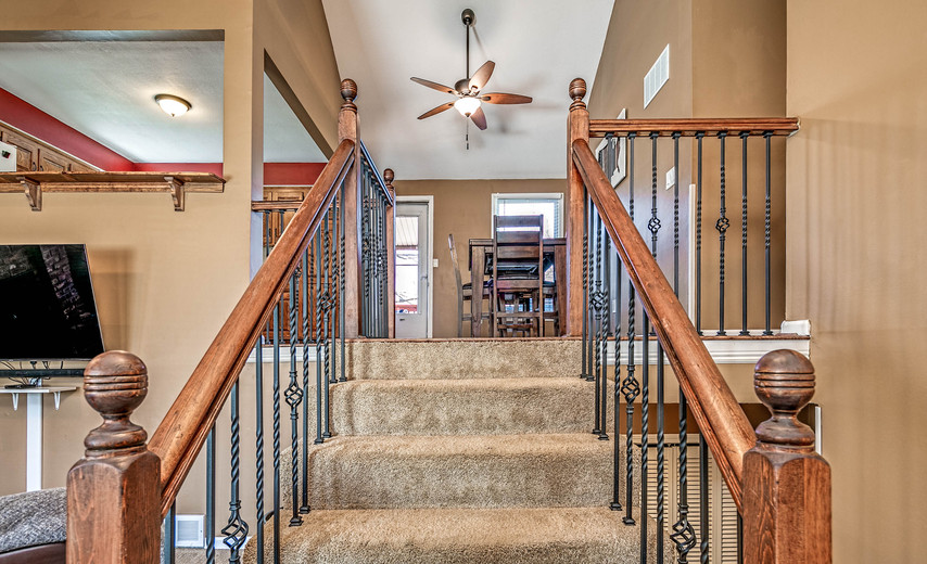 A beautiful staircase greets you as you enter!