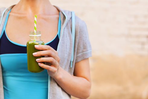 Woman drinking vegetable smoothie after