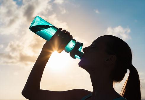 Woman drinking water.jpg