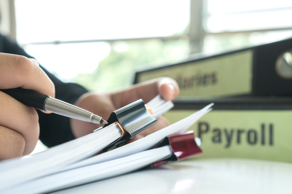 business owner managing payroll