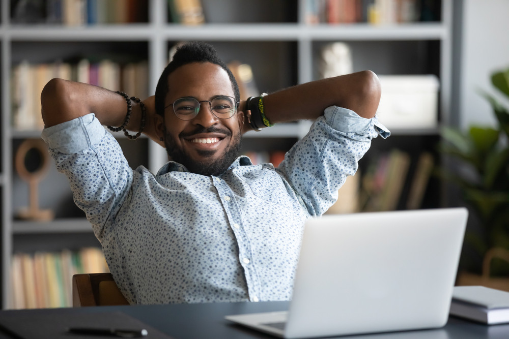 Employee enjoying working from the office because of employee wellness programs