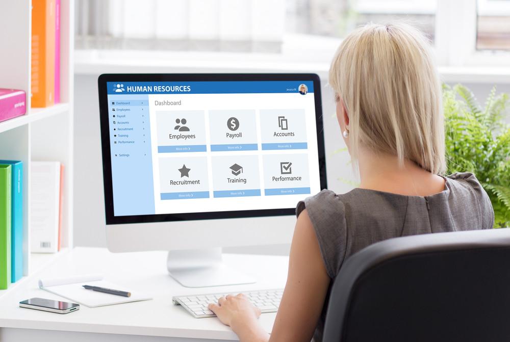 women using online payroll service portal