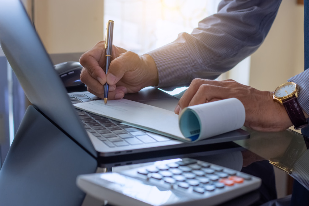 small business owner dealing with payroll for the company