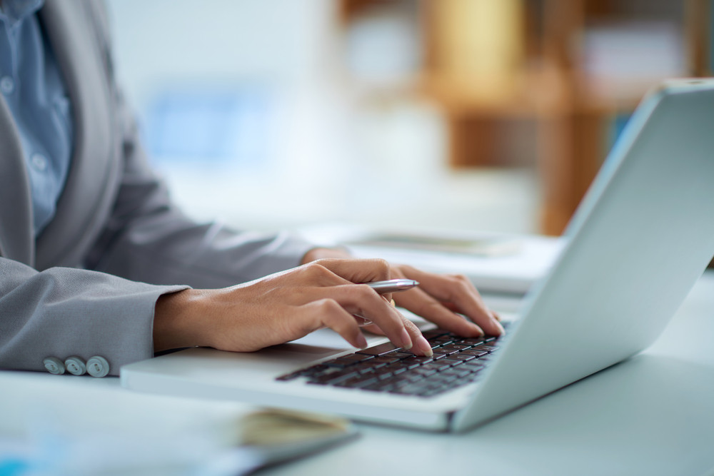 business owner working on laptop for payroll purposes