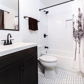 pewter grout and sleek white subway til
