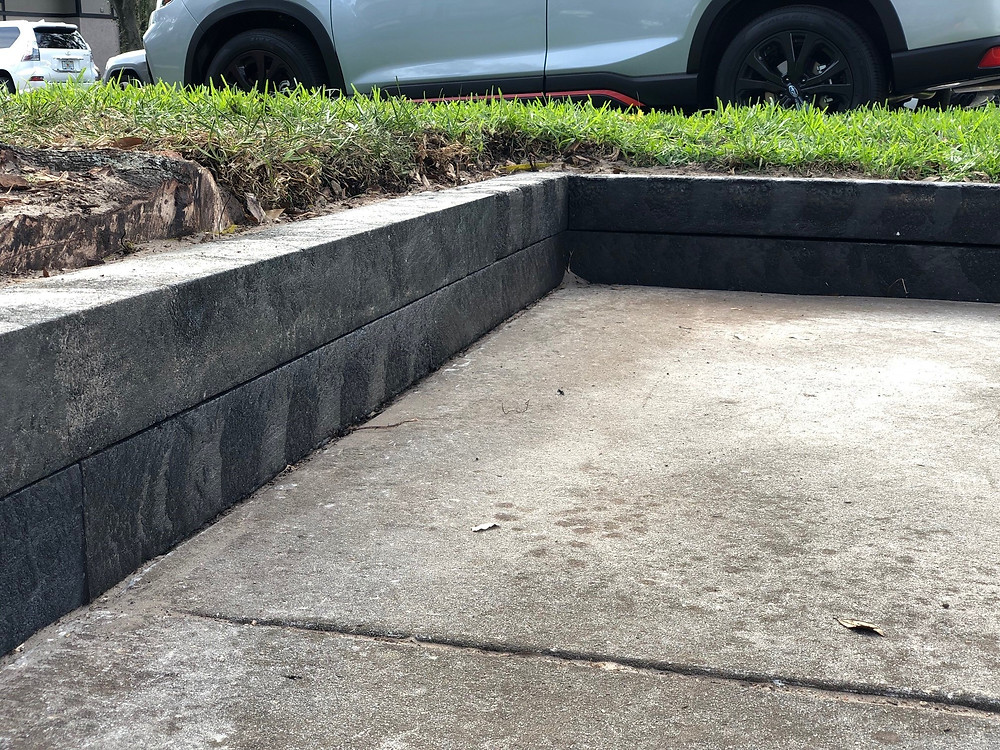 Parking Lot Retaining Wall with BestPLUS Black 6x6 Recycled Plastic Landscape Timbers