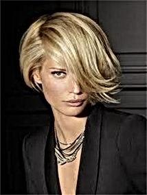 Blonde woman with an asymmetrical bob.