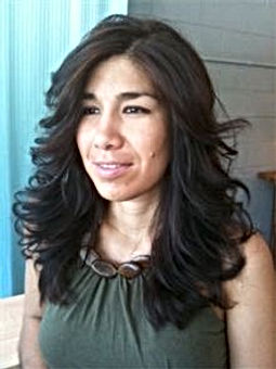 A brunette woman with a free-falling, waterfall haircut.