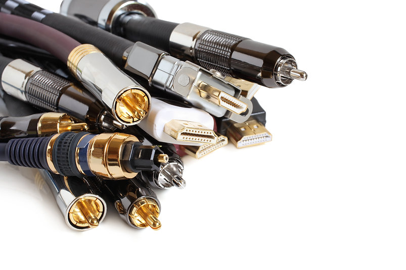 Group of audio/video cables on white bac