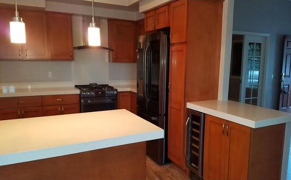 Kitchen Remodel with New Cabinets and Counter Tops - Champion Construction Company