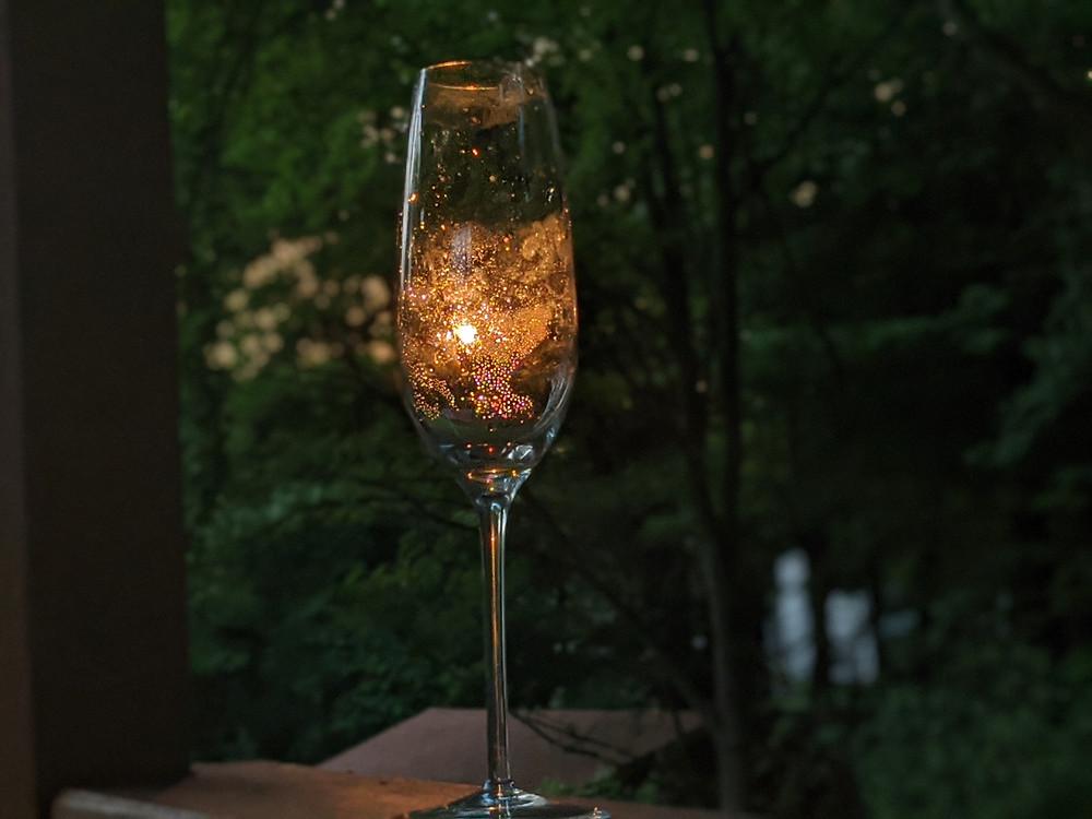 Champagne glass illuminated by sunset
