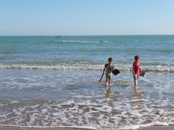 Luca & Fergus jumping the waves