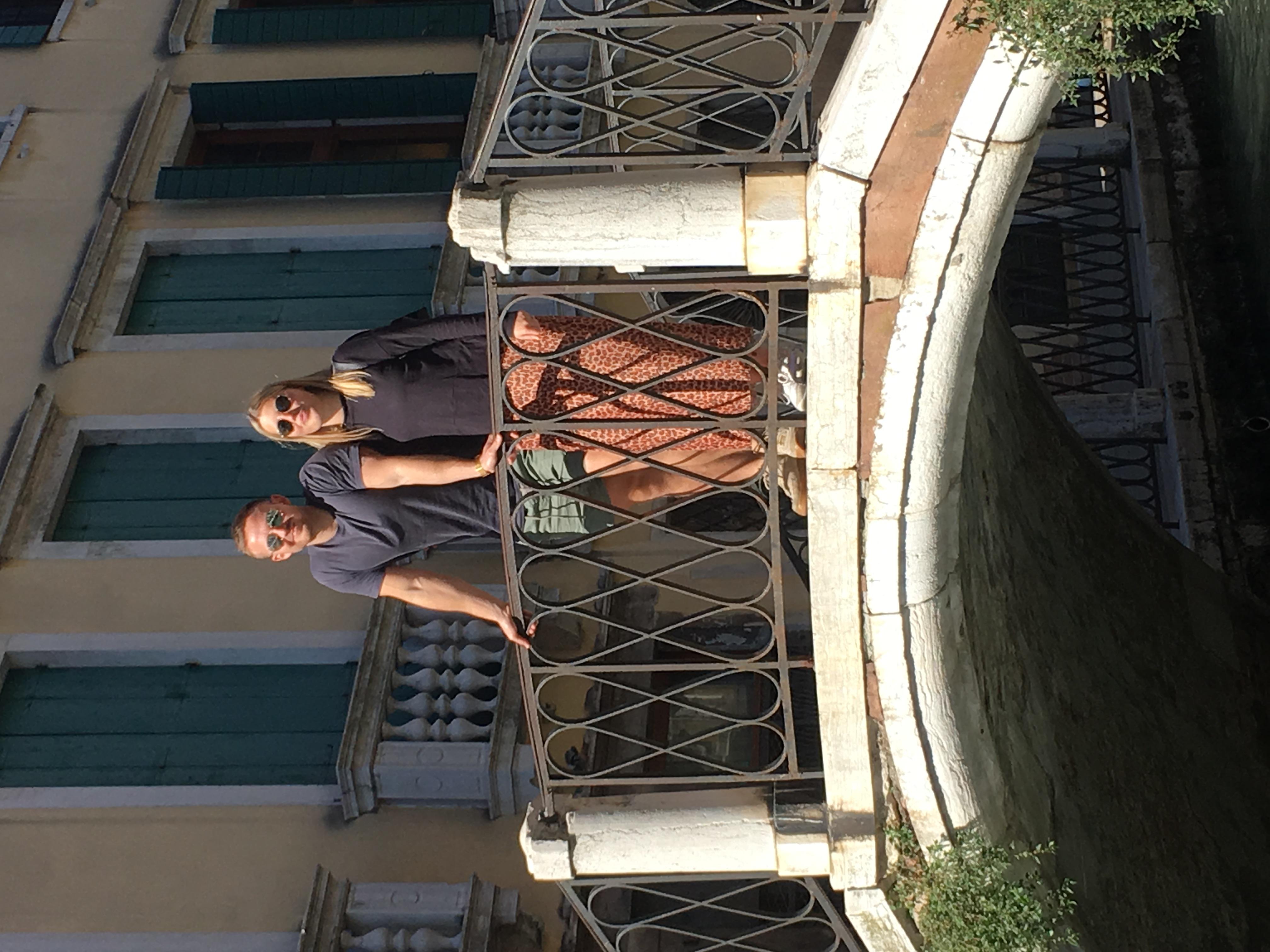 C. Enjoying Venice