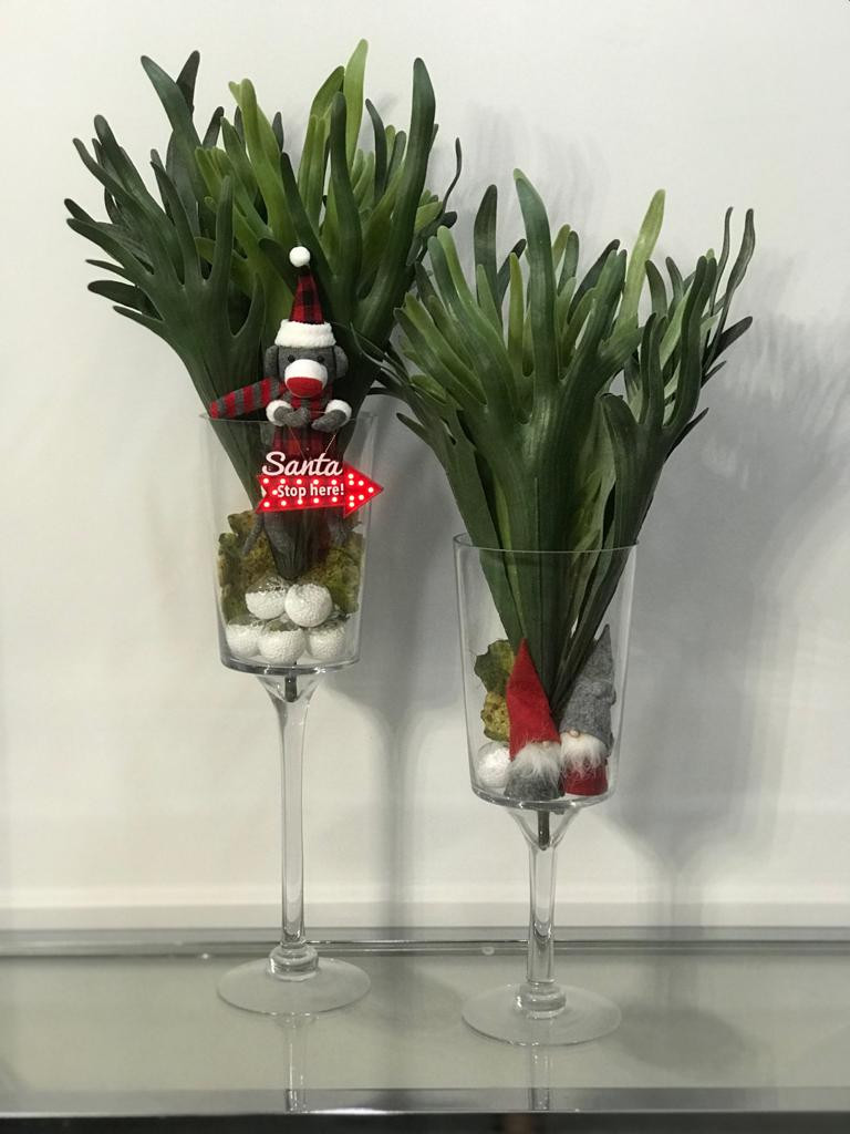 Christmas plush toys in a vase