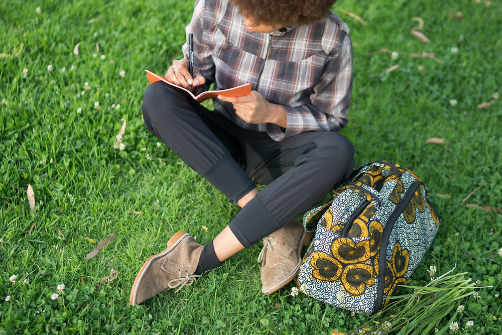 Journaling in the grass