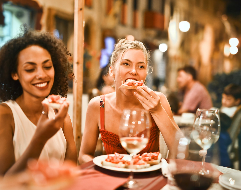 Ladies eating pizza at a restaurant