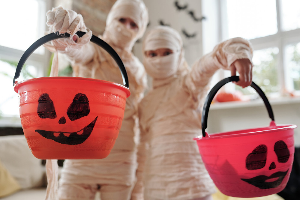 Children dressed up as mummies for trick-or-treating