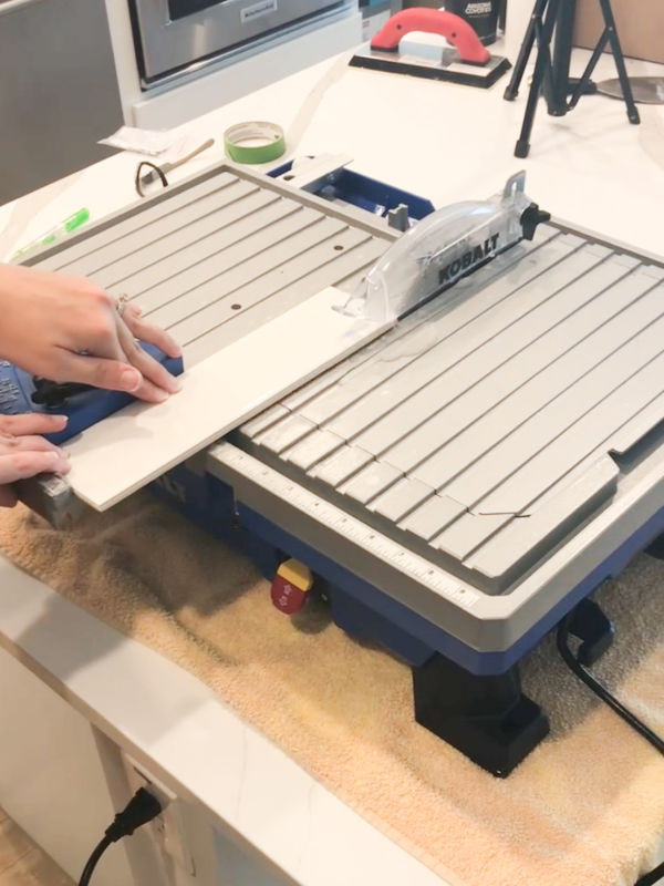 Using a wet saw to cut tile