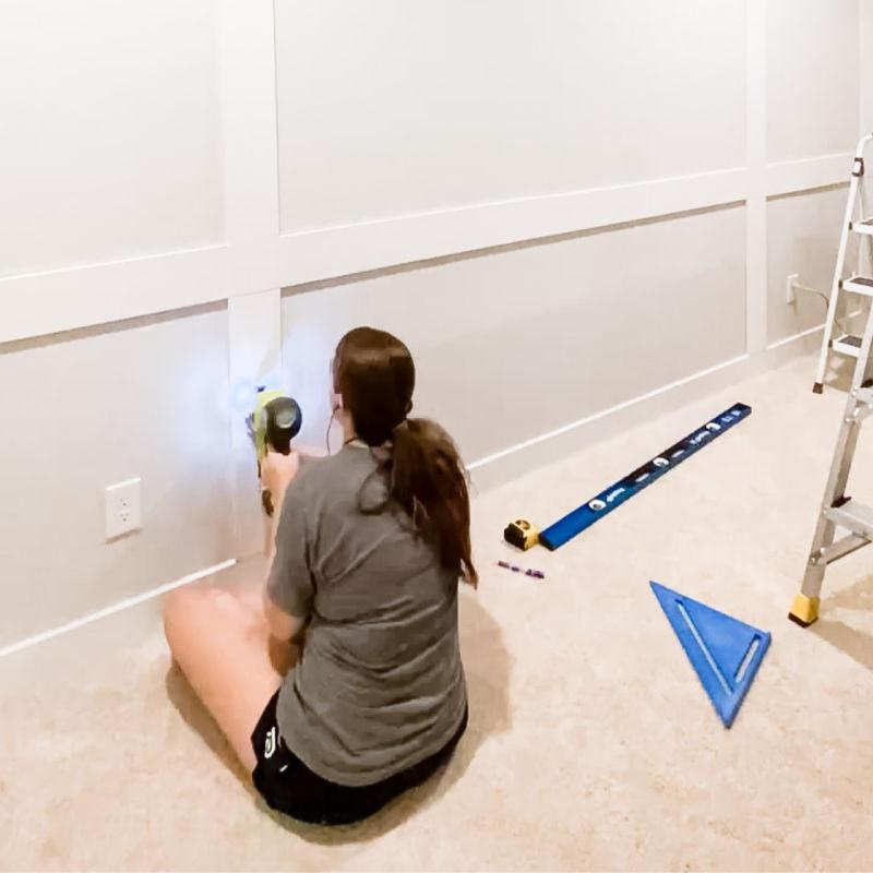 DIY feature wall using a brad nailer to attach trim