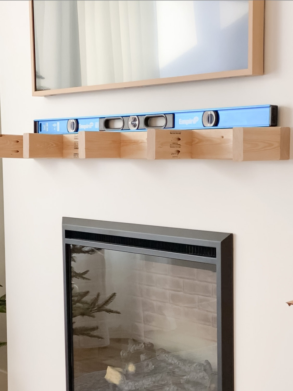 screw wood mantel support to fireplace