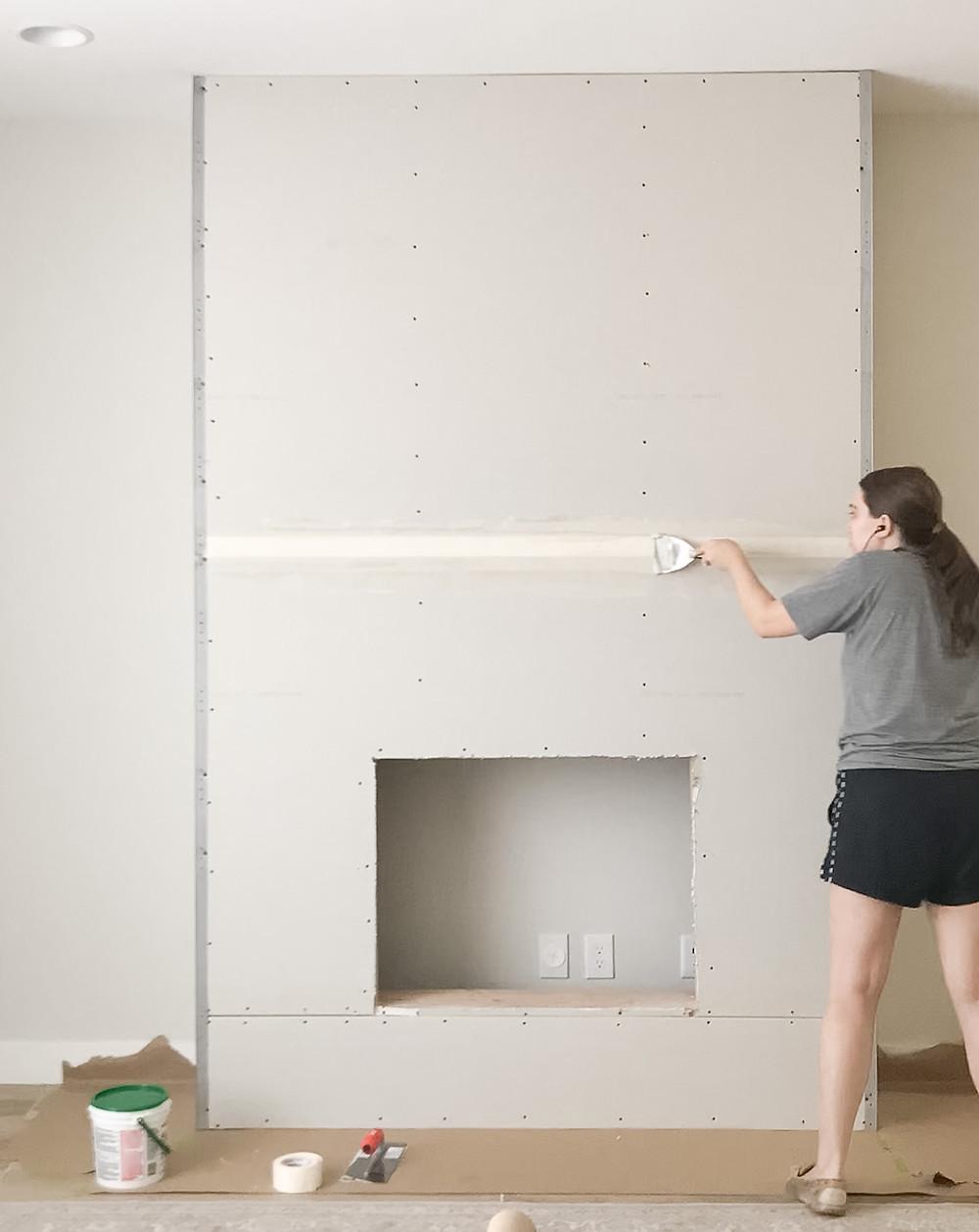 applying tape and mud to drywall seams