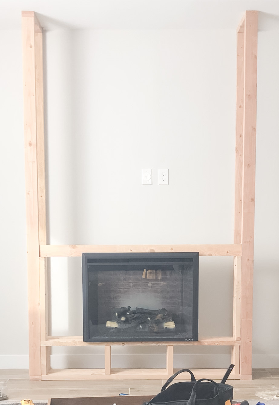 Electric insert in place, secured studs around it.