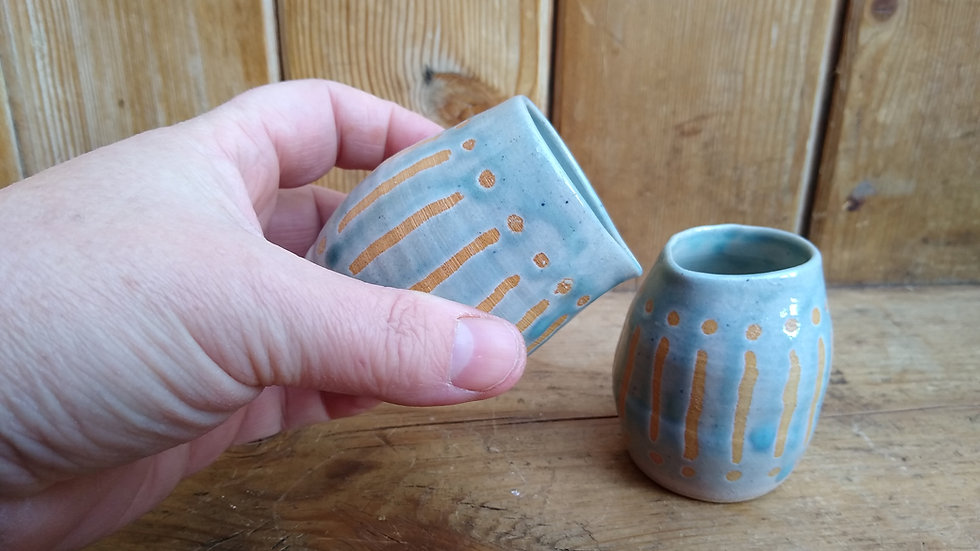 Two Small Teal Milk Jugs