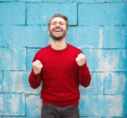 Man in red shirt laughing.jpg
