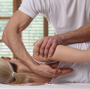 Woman having chiropractic back adjustmen