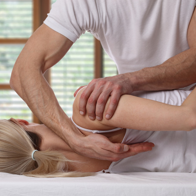 Woman having chiropractic back adjustmen
