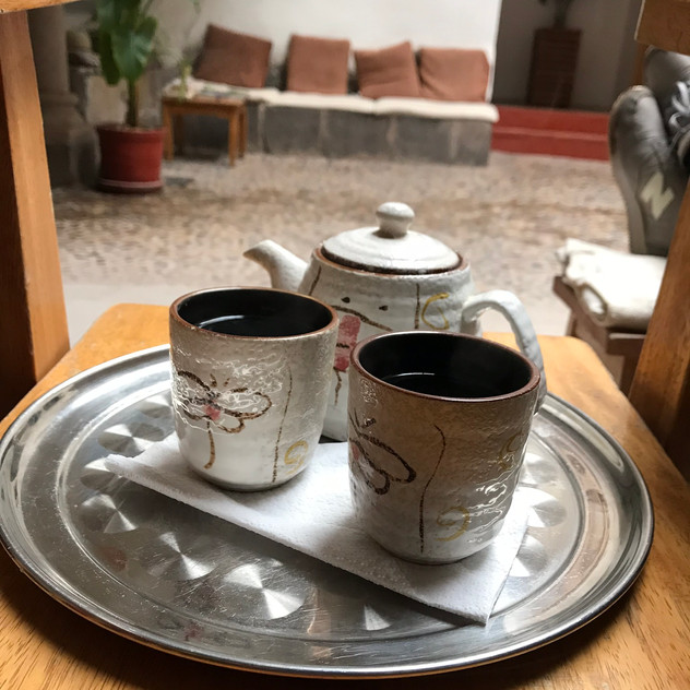 Enjoying some tea while waiting