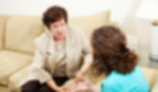Caring female therapist counseling a tee